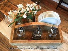 SPRING SALES EVENT     Primitive Style Wooden Cutlery Tray, Rustic Farmhouse Kitchen Tray. This Beautiful and Rustic Wooden Tray Box will add that perfect, warm farmhouse charm to your home. Use this Rustic Wood Carrier Box as a centerpiece on your dining room table filled with fruit or napkins and dinnerware for a touch of primitive rustic elegance, or in a bedroom as a vanity for your make-up or jewelry.  Item is handcrafted from authentic sawmill one inch thick pine wood selected for its…
