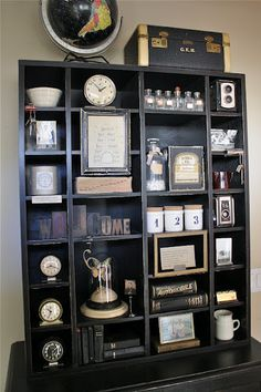 Timeless collection of vintage items, including old letterpress wood type and numbered canisters. Love!