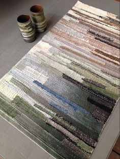 Image of 'tear and repair', an art piece composed of scrap strips of textile hand-stitched to a linen backing