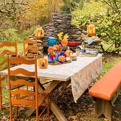 Keep the summer patio furniture out just a little longer -- you'll need it to help create this festive fall party site. A backyard fireplace serves as the focal point, while fun games and fall-theme foods are placed nearby. No fireplace? Not to worry! Spark up a bonfire surrounded by chairs.