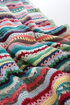 This crochet blanket is a mixture of colors and stitch patterns for a gorgeously bright design