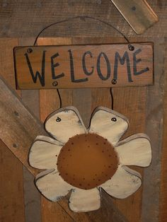 I have hand painted this wooddaisy wall plaque sign withmustard and black underneath. I have added wire to attach the daisy to the welcome sign. It has been distressed and antiqued for more of a primitive look. Nice summer accent for your wall decor.  Measures 11 x 15