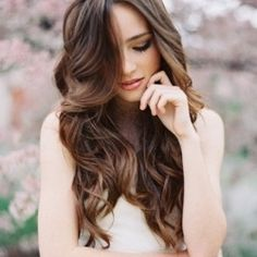 A wavy long-haired look with subtle ombre ends creates a natural and timeless hairstyle. {Photo by Tec Petaja}