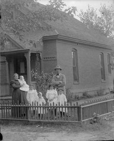 Couple and their five little girls outside of their residence :: History Colorado