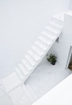 Dar Mim is an understated white home located in the picturesque coastal city of Hammamet, Tunisia. The home is designed by the Parisian based firm Septembre, a firm known for consistently producing elegant and sophisticated designs. Dar Mim is a renovation of a traditionally styled home and courtyard. Septembre preserved the integrity of the existing home by barely touching the front facade and patio, and designing a matching extension in the back.