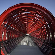 A pedestrian bridge designed by American New York-based architect Bernard Tschumi and French firm Hugh Dutton Associés has opened in La Roche-sur-Yon in France.