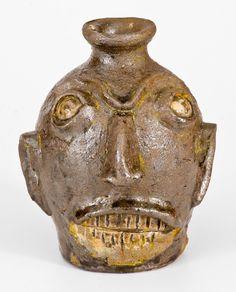 Very Rare Stoneware Face Jug, att. Miles Mill Pottery, Edgefield District, SC -- Lot 443 -- October 22, 2016 Stoneware Auction -- Crocker Farm, Inc., $13,800.