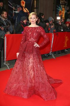 Elizabeth Banks opted for a red gown with lace and sequins from Elie Saab's fall 2014 haute couture collection at the 'Love & Mercy' premiere at the 65th Berlinale International Film Festival. Photo: Away! PR Photos