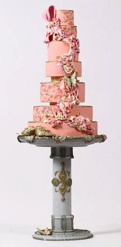 Pink and gold couture wedding cake with ruffles and hand-painted flowers