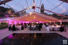 Award winning wedding marquee with clear PVC roof and ivory starcloth by Academy Marquees