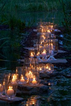 Beautiful candle light flickers softly on the stepping stones across the water!