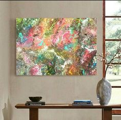 ABOUT Contemporary abstract original acrylic painting in shades of red,black,blue,turquoise,yellow,pink very colorfull painting, very beautiful. This painting makes a statement on the wall as it is very immpresing and very shiny due to silver glitter dust. Photos cannot show the sparkles