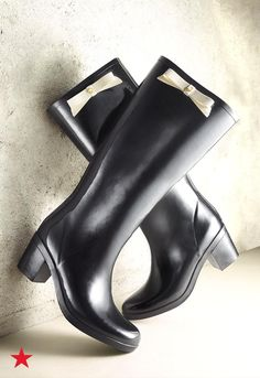 The cutest way to beat the rain, sleet or snow has got to be these adorable Raylan Bow Rainboots from Kate Spade New York. The classic rubber rainboot gets the Kate Spade treatment with a chunky heel and sweet bow detail. Shop this must-have style at Macy's.