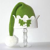 You can have loads of fun in the workshop or shopping, wearing this traditional elf hat with a pom-pom and holly leaves and berries for a little something extra. This really is an adorable fun and festive hat and the peaks on the brim bend forward because it looks cuter that way. The pattern is written for 4 sizes from 6 months all the way to adult and is well suited to an intermediate beginner.