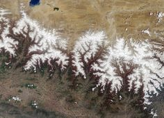 Mountains are the result of tectonic forces pushing the crust upward and erosion tearing some of that crust down. The resulting pattern is a fractal. Image is of the Himalayan Mountains, home to many of the tallest peaks on Earth. The Himalayas are still being uplifted by the collision of India with the Eurasian plate, which began about 70 million years ago.    Image: NASA/GSFC/JPL, MISR Team.