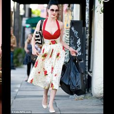 Dita in red and white floral dress