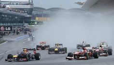 DV1445998  Red Bull driver Sebastian Vettel of Germany (L) leads the pack at on the first corner at the start of the Formula One Malaysian Grand Prix in Sepang on March 24, 2013. AFP PHOTO / PHILIPPE LOPEZ (Photo credit should read PHILIPPE LOPEZ/AFP/Getty Images) 2013 AFP