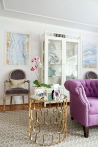 Living Room - gold scalloped side table and purple chair, agate prints framed in acrylic