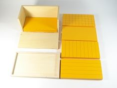 Five Yellow Prisms - Childrens House Range. The Five Yellow Prisms are used in calculating the volume of a rectangular prism. Wooden Box With Lid, Wooden Boxes, Montessori Materials, Kids House, Geometry, Yellow, Mathematics, Image, Wood Boxes