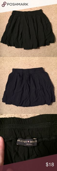 "Basic black Brandy Melville skirt Gently used Brandy Melville skirt. Has elastic waistband . Claims to be one size, but measures a 24"" waist not stretched. Good everyday basic piece. Brandy Melville Skirts Mini"
