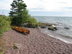 Canoe on a beach at Malone Bay on Isle Royale national Park