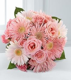 A lovely and playful bouquet. Pink spider gerbera daisies, pale pink gerbera…