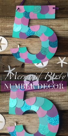 Under the Sea, Mermaid Birthday Party Number Decor. #ad This would be perfect! I love the different color scales on the number. #party #partydecor #mermaid #underthesea #birthday #birthdayparty