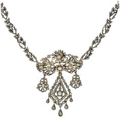 A truly exceptional French pin and necklace set from the Georgian (ca1780) era! Made of silver and old Rose Cut diamonds, this well-preserved piece is absolutely gorgeous. Much of Georgian jewelry is inspired by the beauty of nature, and this exquisite necklace and pin are no exception. The piece resembles flowing vines and delicate leaves with flowers in bloom. The entire piece is encrusted with old Rose Cut diamonds