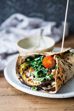 Middle Eastern Eggplant Wrap with a lemony Kale Parsley Mint Slaw with Creamy Tahini Sauce. Keep it vegan or add feta! | http://www.feastingathome.com