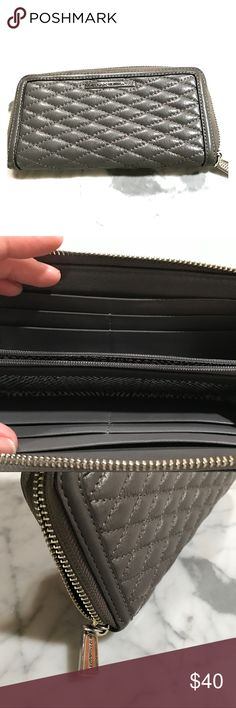 Rebecca Minkoff Gray Quilted Wallet Zip Rarely used slim wallet. Holds all credit cards Zip center pocket. Quilted leather. Rebecca Minkoff Bags Wallets