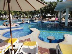 RIU Palace Riviera Maya - an all-inclusive resort where not only do you have a swim-up bar...but swim in booths! A great resort with great facilities makes for a great vacation in Mexico.