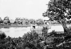 Looking across the Rideau Canal from Ottawa East around the turn of the 19th Century.  The tug (or the barge) is identified as the Geveva.  The real fun is the brand new neighborhood on the other side. It's hard to tell, but from associated photos, I think this is Golden Triangle. I'll try and check that later today.   (LAC PA-009432)