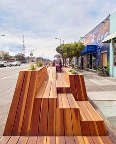 situated in the city's outer sunset district, the versatile, public amenity by interstice architects undulates to form a bike parking platform, lounge chairs, tables, planters and a place for social gathering.