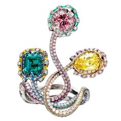 WALLACE CHAN Pink and Yellow Diamond and Emerald Titanium Ring - Of stylized design comprising 3 terminals, one set with a pear-shaped fancy vivid yellow diamond weighing 0.90 carat, one with a brilliant-cut pink diamond weighing 0.60 carat, and a rectangular-shaped emerald weighing 0.74 carat.