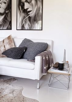 Exposed legs under sofa, skeletal end table, neutral color palette, black and white photography, lots of open floor space visible under furnishings - these elements make minimalist happen