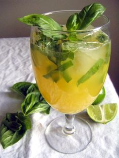 Pineapple Basil Cocktail (3 basil leaves, sliced; quarter of lime; 1/4 cup pineapple juice; 1.5 oz gin; ice; club soda)
