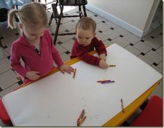 Cover a table in paper to create a wonderful free art for groups experience for todders, preschoolers, or any age! A great way to spark creativity!