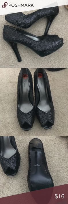 Nine West glitter shoes black 9 1/2 Back of heel has some damage. See pic 4.  Other than that very good condition.  Size 9 1/2 Nine West Shoes Heels
