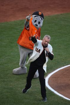 "Former 49er Joe Montana leads a ""Go Giants"" chant with Giants' mascot Lou Seal before the start of Game 5 of the National League baseball championship series against the St. Louis Cardinals at AT&T Park in San Francisco, Calif., on Thursday, Oct. 16, 2014. (Jane Tyska/Bay Area News Group)"