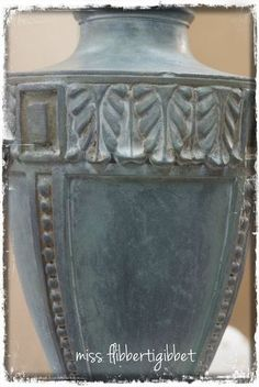 "How to: Zinc Faux Finish - This started as a shiny brass lamp. First she painted it with dark gray primer & then with gesso and then a coat of ASCP ""Duck Egg Blue"". Dark wax was then rubbed into some of the crevices and the entire piece was finished with a coat of clear wax and buffed to get a dull shine."