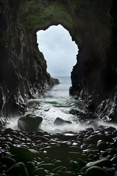 """The mermaid's Cave is a huge sea cave which lies underneath Dunluce Castle, on County Antrim's North Coast (see my earlier pic). It's filled with the noise of crashing waves and is always atmospheric. If you visit Dunluce Castle, this cave is a must see"" Oh The Places You'll Go, Places To Visit, Mermaid Cave, Sea Cave, Famous Castles, Real Castles, Ireland Landscape, Irish Landscape, Ireland Travel"