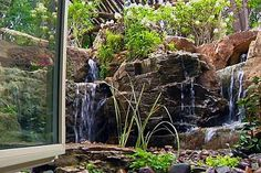 This basement office now has a beautiful view of a small waterfall. Open the window to enjoy the sound!