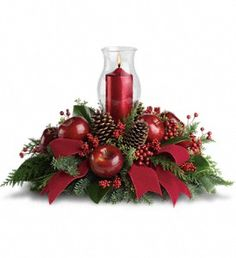 Merry Magnificence  - Shiny red apples make this centerpiece a very tasteful gift. The beautiful hurricane glass and ruby red pillar candle complete the stylish arrangement!