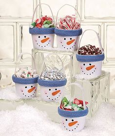Cute holiday gift idea- these would be easy to make with flower pots or a tin/pail, paint and fleece to go around rim. You could even put the person or familys name you are giving it to around the rim with some felt letters if you desire! One more idea- display these on a dessert table for example, maybe a sundae bar and each snowman holds a different topping!