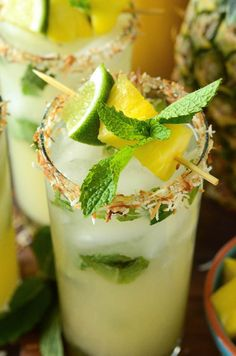 Pineapple Coconut Mojitos are a delicious remix of the classic mint mojito and the piña colada! This simple mojito recipe is easy to make and a delicious summer cocktail! Pineapple Mojito, Mint Mojito, Pineapple Coconut, Rum Cocktails, Summer Cocktails, Cocktail Recipes, Popular Cocktails, Mojito Drink, Mojito Cocktail
