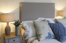 I always prefer to use tall headboards if the bedroom has a high ceiling. I like to keep the height of the bedside lamps in the correct proportion to the headboard. I always use lots of cushions that mix and match on white bedlinen