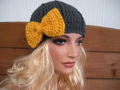 Crocheted beanie with bow @Christie Cromar  one for me and one for Harper in the same yarn as her scarf??