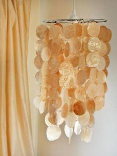 Faux Capiz Shell Pendant --  wax paper, glitter mod podge, baking @ 300 for about 20min