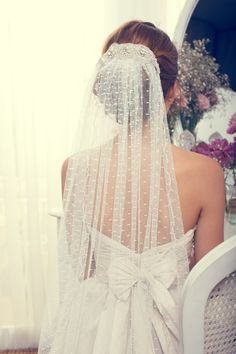 Stunning Polka Dot Veil. Such a pretty bow on the back.