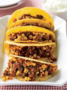 The Mexican dish known as picadillo makes a tasty filling for tacos. Although usually made with ground beef and spices, here ground turkey blends deliciously with cinnamon, cumin, and allspice.